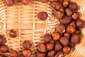 Hazel nuts on a wicker basket — Stock Photo