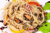 Tasty italian pasta with seafood. — Stock Photo