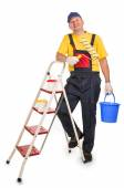 Worker on ladder with roller and bucket. — Stock Photo