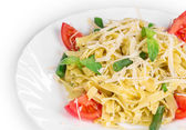 Tagliatelli pasta with tomatoes — Stock Photo