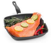 Fresh salmon fillet on a pan. — Stock Photo