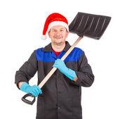 Worker holding black shovel. — Stock Photo