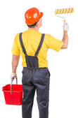 Worker with roll and bucket. — Stock Photo