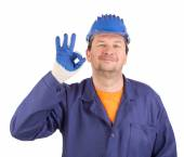 Worker shows hand sign okey. — Stock Photo