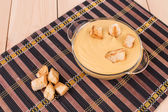 Pea soup in a bowl with crouton. — Stock Photo
