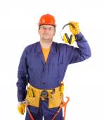 Worker in hard hat holding ear muffs. — Stock Photo
