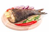 Fried carp tail with lemon and pepper. — Stock Photo