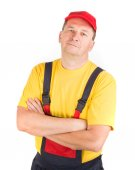 Worker in hat with crossed arms. — Stock Photo