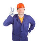 Travailleur avec le signe de la paix. — Photo
