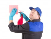 Worker holding spray bottle and washcloth. — Stock Photo