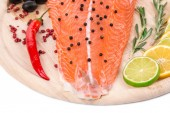 Salmon fillet with pepper, lemon and lime — Stock Photo