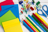 Colorful school requisites on a desk — Stock Photo