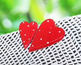 Beautiful red hearts on a lace tablecloth — Stock Photo