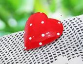 Beautiful red heart on a lace tablecloth — Stock Photo