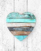 Wooden heart on grungy wooden texture — Stock Photo