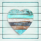 Wooden heart on vintage background — 图库照片