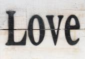 The word love on a wooden vintage background — Стоковое фото