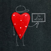Alone heart on the chalkboard — Stock Photo