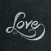 The word love on the chalkboard — Foto Stock