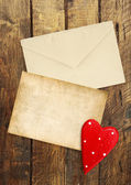 Old letter on the wooden background — Stock Photo
