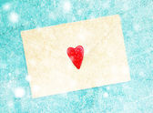 Envelope with heart on wooden background — Stock Photo