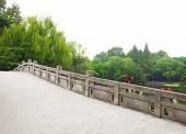 Stone bridge in a beautiful park — Stock Photo
