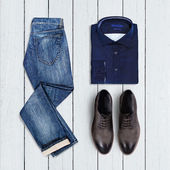 Collage of modern men's clothing on a white wooden background — Stock fotografie