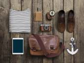 Hipster clothes and accessories on a wooden background — Stock Photo
