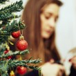 Girl preparing decorations for xmas tree — Stock Photo #60273123