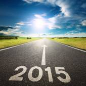 Driving on an empty road to new 2015 — Stock Photo