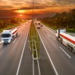 Two white trucks in motion blur on the highway — Stock Photo #56885091