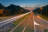 Long exposure photo on a highway at dusk — Stock Photo