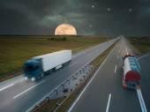 Trucks on highway at night of the full moon — Fotografia Stock