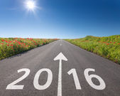 Driving on empty road towards the new 2016 — Stock Photo