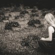 Mourning girl at cemetery — Stock Photo #57768275