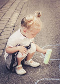 Girl with chalk in hand — Stok fotoğraf
