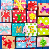 Little presents wrapped in colorful paper — Stock Photo