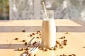 Bottle with almond milk — Stock Photo