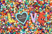 Love on confetti — Stock Photo