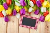 Fresh tulips on wooden background — Stock Photo