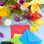 Fresh tulips on blue wooden background — Stock Photo #61680307