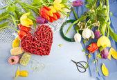 Fresh tulips on blue wooden background — Stock Photo