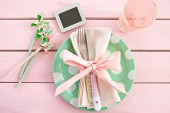 Colorful plate on rustic pink background — Stock Photo
