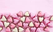 Colorful chocolates in heart-shape — Stock Photo