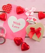 Chocolate hearts and colorful gift bag — Stock Photo