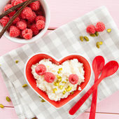 Rice pudding with raspberries — Stock Photo