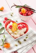 Rice pudding with raspberries — Stock Photo