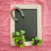 Vintage chalkboard with lucky charms — Stock Photo