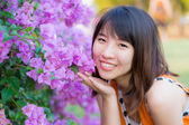 Cute Thai girl is very happy with purple Kertas — Stock Photo