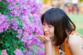 Cute Thai girl scent a purple Kertas. She loves flowers. — Stock Photo